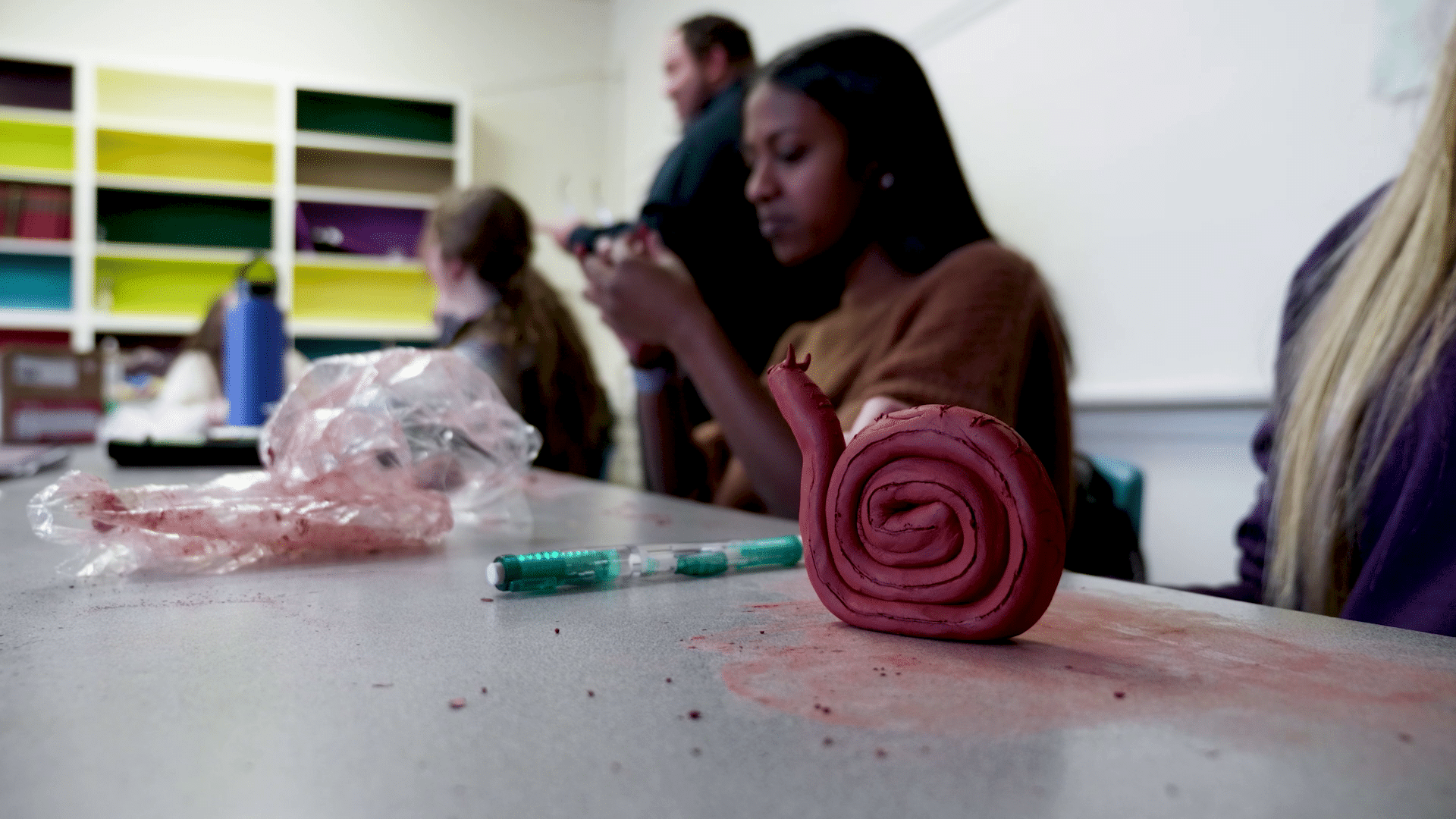 Students creating clay sculptures